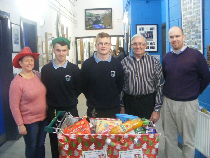 Kelvin O'Brien and Aaron Quinn (3rd Year) present our food trolley to Pat Furlong from the charity.